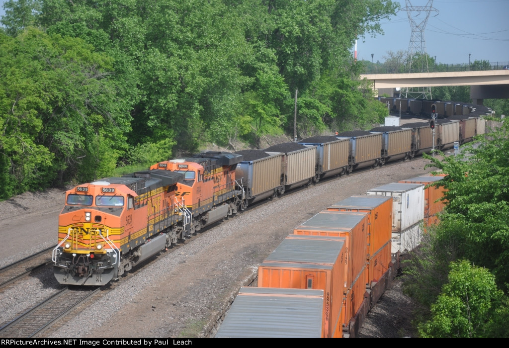 Eastbound loaded coal train winds through Westminster